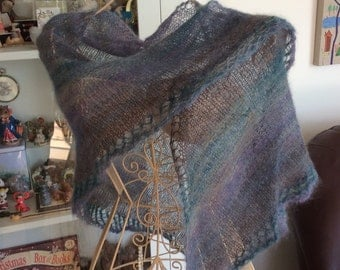 Handknitted shawl , beautifully light and soft . Very fine but warm