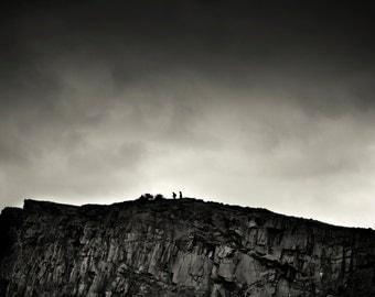 The Crags, original fine art photography, print, scotland, edinburgh, cliff, rock, nature, mountain, black and white, landscape, man, dark