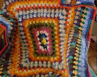 45x60 granny square crochet afghan.  textured and very colorful.