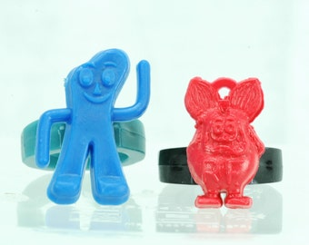 Vintage 1960s gumball charm rings - blue GUMBY & red RAT FINK