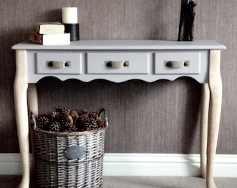 Umberstone console table