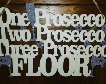 One prosecco, two prosecco, three prosecco, floor