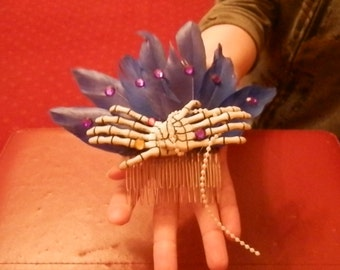 Skeletal Hands and Feather Hair Comb