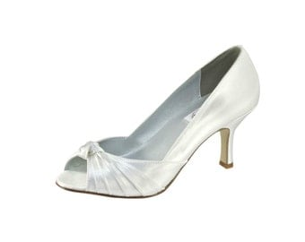 Ida Dyable Satin peep toe with a knotted vamp.