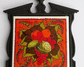 Black Cast Iron and Orange Fruit and Nut Tile Trivet
