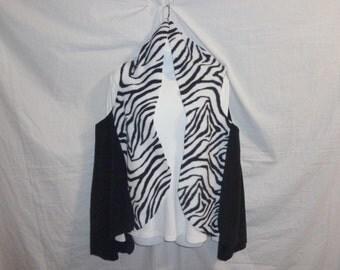 Serape (Sir-wrap-pay) a knee length, wrap-a-round, jacket, shawl, poncho, vest like, very soft outer garment, many colors. Wear it 5 ways!