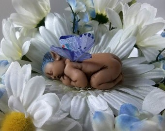 Sleeping White Gerber Daisy Baby Fairy Figurine