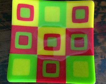 Small Retro Fused glass square tray in red, yellow and green square pattern.