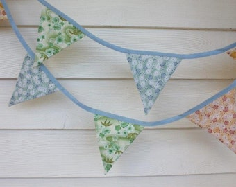 Handmade fabric bunting in fresh spring/summer colours - eleven double sided flags