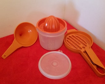 Vintage tupperware flour sifter, bowl with lid, funnel burnt orange tupperware, and tupperware juicer