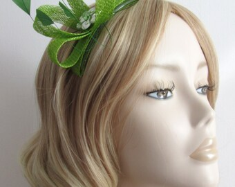 LIME GREEN FASCINATOR, Made of Sinamay, with diamond tipped coque feathers,flower bead,on a clear 4in comb