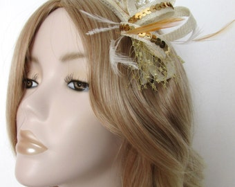 IVORY and GOLD FASCINATOR, with Stripped hackle Feathers,metallic gold sequins, on a comb