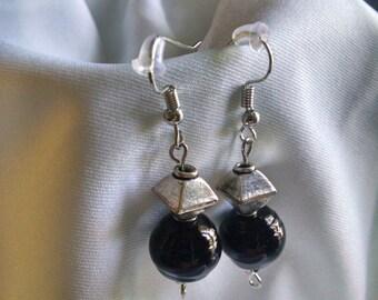Black and metal dangle earrings