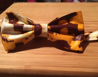 Men's handcrafted  bowtie made from a handpicked African themed waxed fabric