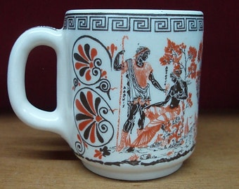 Handmade ceramis mug in white glaze, decorated with ancient greek scenes