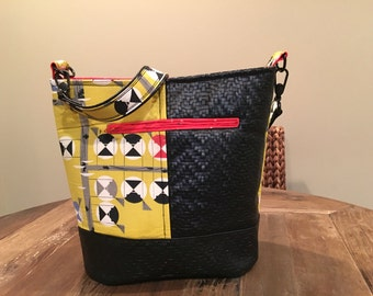 Bucket shoulder bag in Charlie Harper fabric and woven faux leather. SALE Price reflects 30% off from original price.