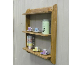 Wall mounted shelf unit. Kitchen shelves or cd dvd and paperback book shelves