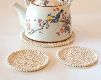 Set of hand crocheted cotton coasters - Set of cream coasters and a teapot pad