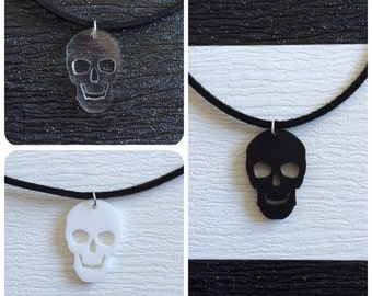 black suede choker with acrylic skull charm.