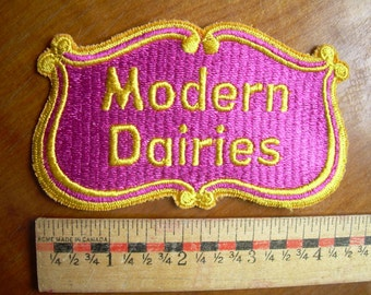 Modern Dairies Winnipeg Canada Patch 4.25 x 2.5 inches, unused from the 1980's