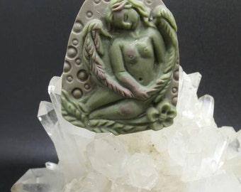 Carved Ribbon Jasper Angel Pendant.