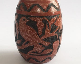 Aztec/Latin Handmade Red and Black Glazed Terra Cotta Vase w/ hand carved traditional symbols, details, and motifs.   Unmarked.