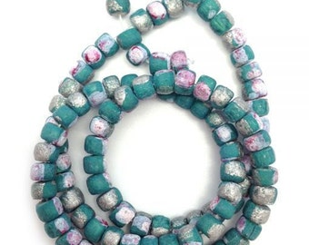Coconut beads, aqua with stains, 5 mm, Pukalite, 1 St