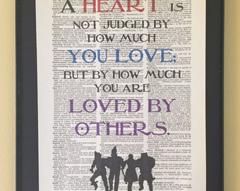 A heart is not judged by how much you love but by how much you are loved by others;  Wizard of Oz page art;