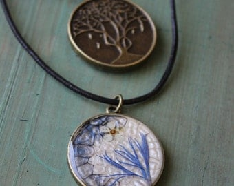 Small white and blue flower, Medallion antique gold, necklace leather