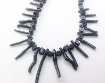 Vintage, black coral bead necklace with long branch coral beads.