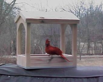 Open air bird feeder