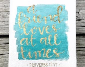 """4x5"""" hand-painted, hand-lettered """"a friend loves at all times"""" Proverbs 17:17 teal and gold canvas 