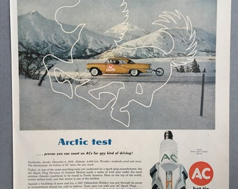 1957 AC Spart Plugs Print Ad featuring an Oldmobile Holiday - Arctic Test