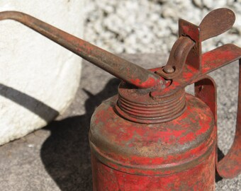Vintage red oil can