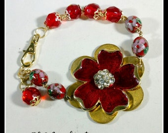 Red Enameled Flower with Rhinestones, centers this bracelet made with a brass daisy base, Cloisonne Enamel beads & Swarovski crystals