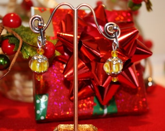 Clip on earrrings made with yellow lamp worked beads