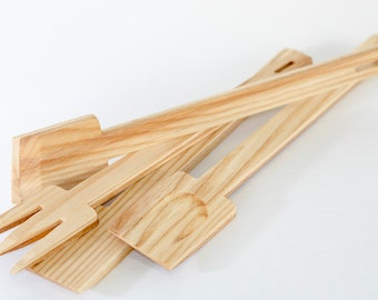 Set of ladles natural wood ash in the bathroom of olive oil