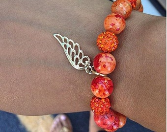 Burnt Orange Beauty with a Angel Wing Charm