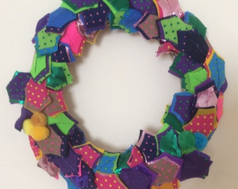 Christmas wreath, multi-coloured using fabric and felt, decorated with Pom Poms