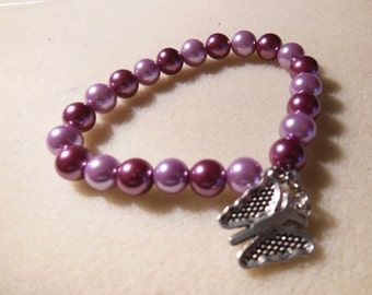 Two tone purple elastic bracelet with butterfly charm