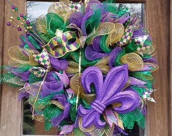 Mardi Gras wreath with glittered fleur-de-lis and fun Mardi Gras mask