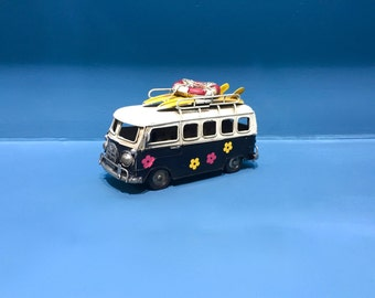 Vintage collectible miniature hippie VW bus with surf