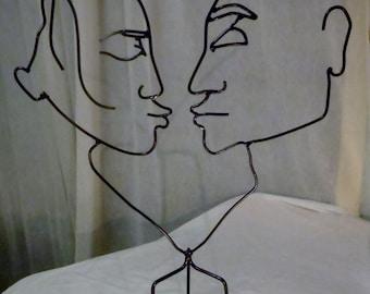The Kiss.  Metal Sculpture.  Shadow Art