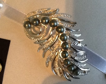 Sarah Coventary silver feather brooch with green faux pearls