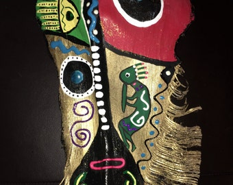palm tree fronds, masks, tiki mask, hand painted masks, kokopeli design