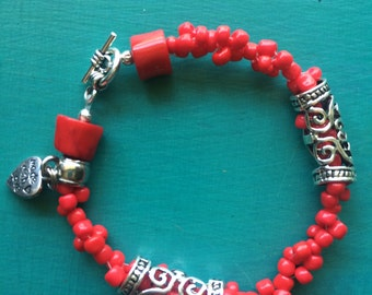 Red Beaded Bracelet With Metal Accents