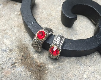 Vintage Silvertone stud earrings with red crystals