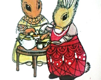 Two Lady Rabbits drinking Tea