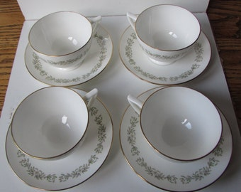Four MINTON cups and saucers