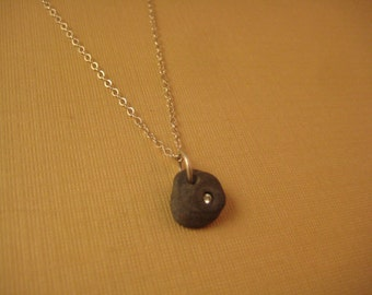 Diamond in pebble on fine chain